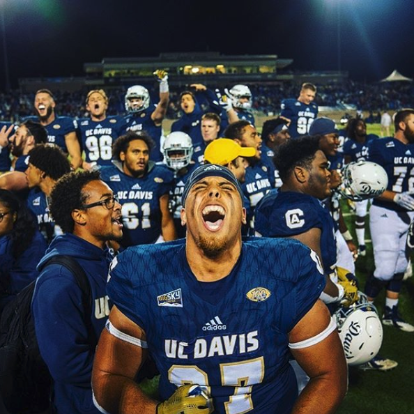 Image of UC Davis Aggies football team after first Division 1 playoff game.
