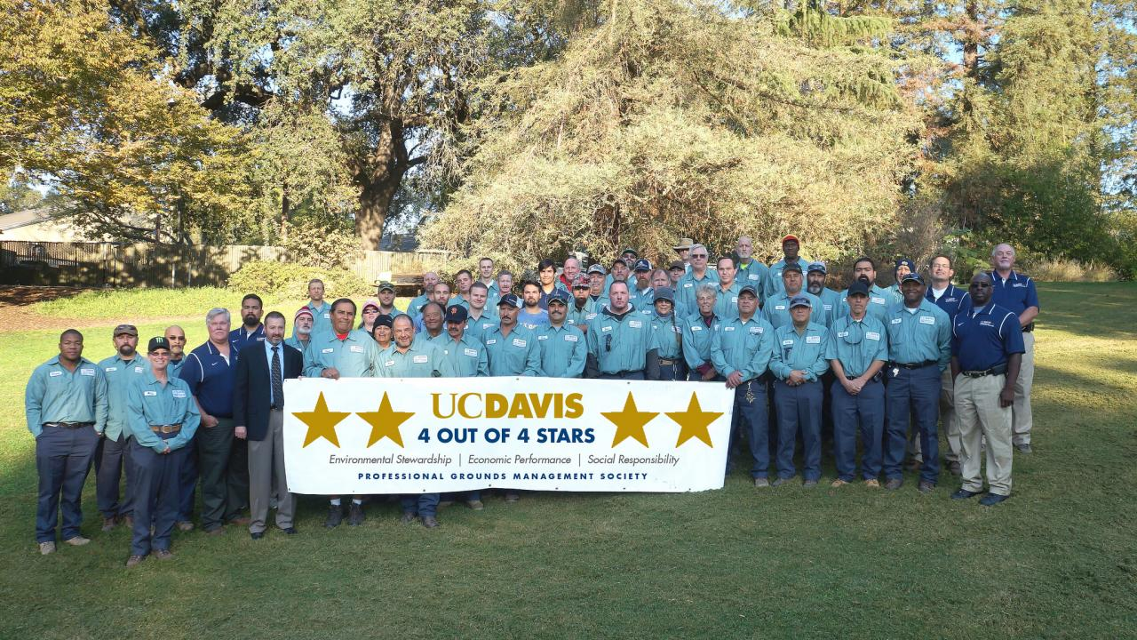 Image of UC Davis Grounds and Landscape Services staff after receiving their 4-out-of-4 star PGMS award.