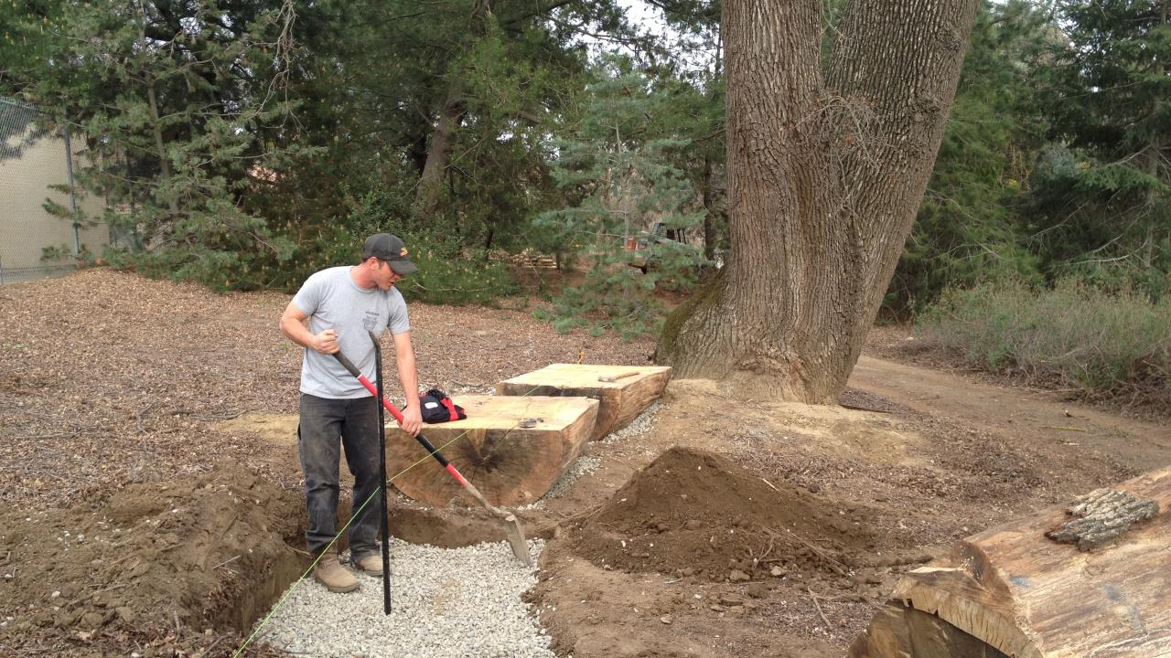 Image of John Gainey constructing his design for the UC Davis Animal Science GATEway Garden.