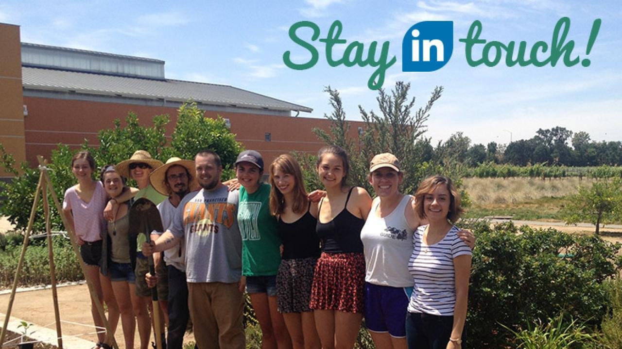 "picture of edible landscape interns with ""Stay in touch"" added in the corner"
