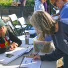 Image of individual signing up for membership with the Friends of the UC Davis Arboretum and Public Garden.