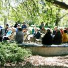 community members sitting in the peter shields oak grove