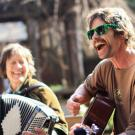 Image of the UC Davis Arboretum and Public Garden's bi-weekly folk music jam session on Wyatt Deck.