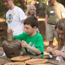 Image of child creating acorn flour from acorns.